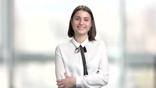 Young smiling woman talking to camera. Pretty cheerful woman talking and looking at camera. Female television presenter is speaking.