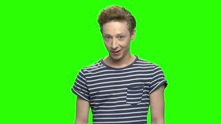 Young teenage boy, facial expressions. Green screen hromakey background for keying.
