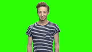 Young teenage boy laughing hard. Green screen hromakey background for keying.