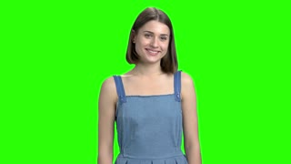 Young woman, different emotions expression. Portrait of teen girl with facial expressions, positive and negative emotions. Green screen hromakey background for keying.