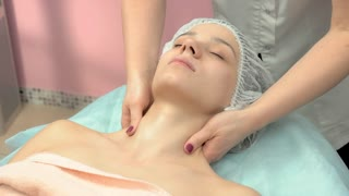 Young woman having neck massage. Relaxed girl with eyes closed. Health tips from chiropractors.