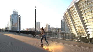 Young woman is rollerblading. Lady on city background. Cheerful ride through home city. Energy of youth is boundless.