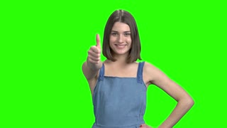 Young woman shows different gestures. Like, ok and victory gestures. Green screen hromakey background for keying.