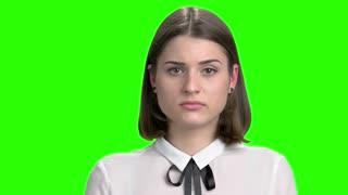 Young worried girl hearing bad news. Facial expressions, upset, thrilled and nervous. Green screen hromakey background for keying.