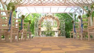 Wedding arch and chairs. Small bouquets with ribbons. Holiday of love and unity.
