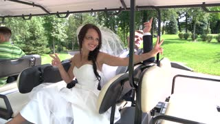 Wedding couple in vehicle. Groom and smiling bride. Ride into happy life. The new beginning.