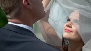Wedding couple kissing. Smiling bride in veil. The joy in your eyes. Marriage and happiness.