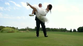 Wedding couple outdoors. Groom is holding bride. Be with me forever. Joy and happiness for two.