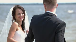 Wedding couple outdoors. Smiling bride on water background. The loving hearts. Find your path to happiness.