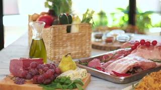 Wooden table with food. Fruits, roquefort cheese and meat. Blend the tastes.