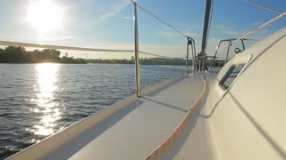 Yachting along the river. Rest on a yacht. Yacht came out on a voyage. Travel by sea on a yacht.
