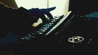 Artistic shot of hands typing on a vintage typewriter. Film script, more styles in the gallery
