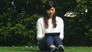 Asian beautiful friend browsing the web, networking and writing emails on a tablet, 4k