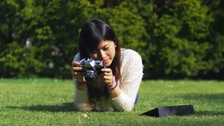 Beautiful asian amateur photographer taking photos of flowers. 4K video