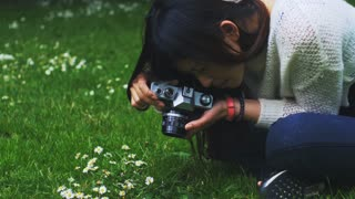 Beautiful asian amateur photographer taking photos of flowers. 4K video