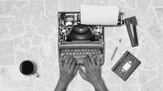Black and white from above shot of hands typing on a vintage typewriter with a coffee next to it. Space for writing, Film script, book or letter. More styles in the gallery