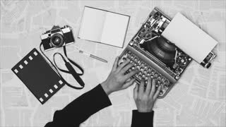Black and white From above shot of hands typing on a vintage typewriter, with an old 35mm film camera, writing a reportage documentary, war notes. Space for writing, Film script, book, letter, newspaper. More styles in the gallery
