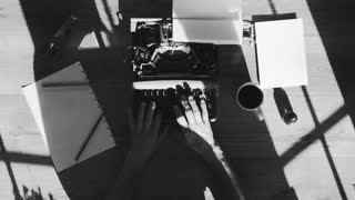 Black and white from above shot of hands typing on a vintage typewriter.Space for writing, Film script, more styles in the gallery…Beautiful shadows