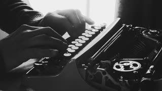 Black and white shot of hands typing on a vintage typewriter next to bright window. Writing a Film script, book or letter. More styles in the gallery …Beautiful shadows