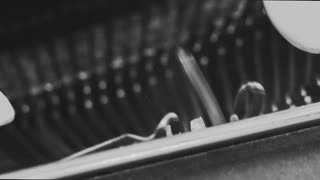 Close up of a typewriter, inside mechanism. Black and white