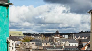 Clouds above house roofs...Irish cityscape timelapse