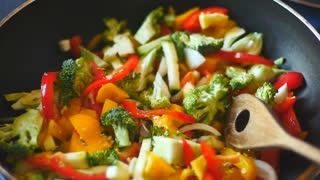 Cooking a lovely stir fry with some wonderful and tasty vegetables . Slow motion full HD