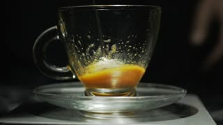 Extreme close-up of cream making for cappucino coffee on a transparent cup. Slow motion HD