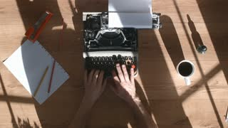 From above shot of hands typing on a vintage typewriter. Space for writing, Film script, book or letter. More styles in the gallery. Beautiful window's shadows