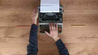 From above shot of hands typing on a vintage typewriter. Space for writing, Film script, book or letter. More styles in the gallery