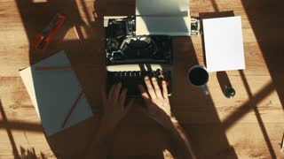 from above shot of hands typing on a vintage typewriter.Space for writing, Film script, more styles in the gallery…Beautiful shadows