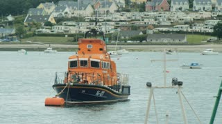 Lifeboat floating in the shore ready for action