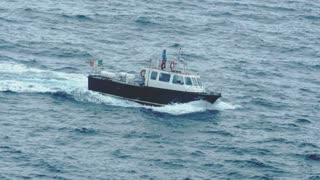 Safety boat returning to shore after emergency