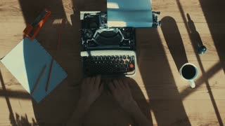 Shot from above of hands typing on a vintage typewriter. with text: Title, Chapter 1. Film script, book or letter. More styles in the gallery