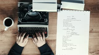 Stylish graded shot of hands typing on a vintage typewriter. with text: Chapter 1 and page of fake script. Film script, book or letter. More styles in the gallery