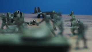Symbolic toy soldiers made of green plastic, with war sounds effects