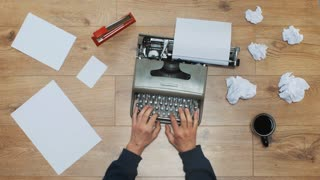 A writer typing on a vintage typewriter with the writer block