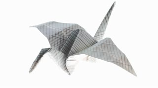 Beautiful origami crane animated. Origami crane flying in white background. 4K video