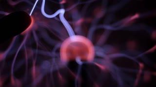 Plasma ball, Tesla Coil experiment with electricity, plasma lamp. 4k video