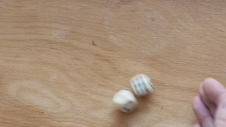 Rolling dice on a wooden board with result 5+1=6. 4K video