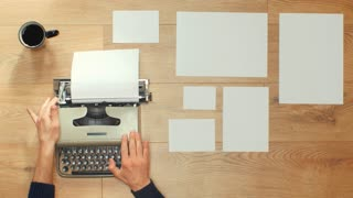 Typing an article with a vintage typewriter