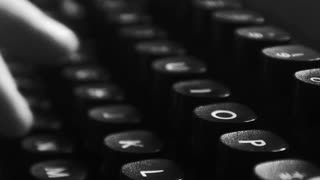 Typing on a vintage typewriter machine. Writing a love letter by the window, 4K black and white