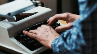 Typing on a vintage typewriter machine. Writing a love letter by the window, 4K.