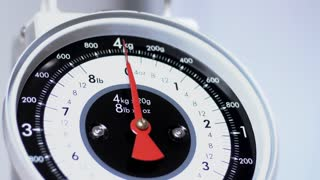 Vintage scale close up, view of numeric household scale instrument and indicator, measuring food for preparing meals. 4K video