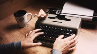 Woman hands typing a letter, coffe mug and origami. Full HD