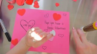 A Female Creating A Happy Valentines Day Card With That Says Love You 2