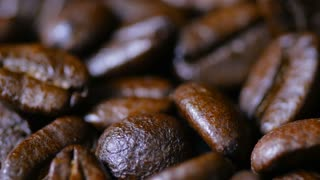 Macro Close Up Brown Coffee Beans Rotating Around