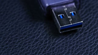 Macro Close Up Of Computer Usb Flash Drive Rotating Around