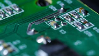Macro Close Up Of Electronic Chip With Circuits Rotating Around 2