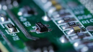 Macro Close Up Of Electronic Chip With Circuits Rotating Around 3