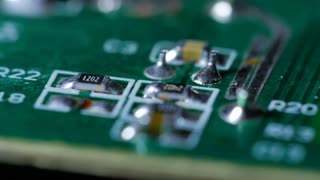 Macro Close Up Of Electronic Chip With Circuits Rotating Around 4